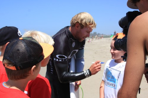 Groms rush to congratulate San Clemente's Tanner Gudauskas on a great run in the Oakley Lowers Pro after being eliminated in the quarterfinal by Wade Carmichael (AUS). Photo: Andrea Swayne