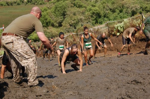 Participants in the 2015 Camp Pendleton mud run crawl their way up a hill on June 6. Photo: Courtesy MCCS Camp Pendleton