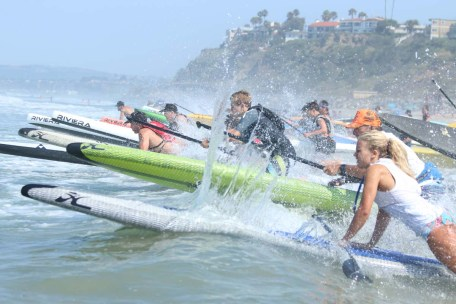 San Clemente Ocean Festival contestants navigate the surf during a paddleboard competition. Photo: Eric Heinz
