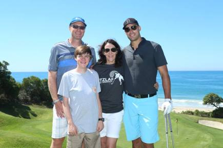 Anaheim Ducks captain Ryan Getzlaf, right, poses with Hawken Miller and his parents Paul and Debra during the Getzlaf Shootout charity golf tournament on Sept. 15. Photo: Courtesy