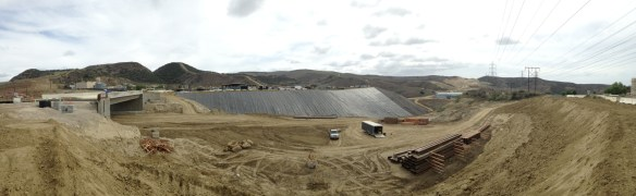 The new roadway will go under the Prima Deshecha landfill entrance bridge (left). A waste excavation pit (center) is being prepared for backfill. The La Pata roadway can be seen in the background as it makes its way to San Clemente. Photo: Courtesy