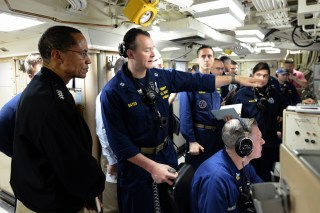 Commander, U.S. Strategic Command, Adm. Cecil D. Haney (left) observes the assistant weapons officer, Lt. Rick Bates (center) give instructions during the 156th successful test flight of an unarmed Trident II D5 missile launched from the Ohio-class ballistic missile submarine USS Kentucky on Nov. 7. Photo: U.S. Navy/Mass Communication Specialist 1st Class Byron C. Linder