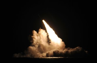 A Trident II D-5 ballistic missile is launched from the Ohio-class ballistic missile submarine USS Kentucky during a missile test at the Pacific Test Range on Nov. 7. The launch was part of a Demonstration and Shakedown Operation (DASO) to validate the readiness and effectiveness of an SSBN's crew and weapon system. Photo: U.S. Navy photo