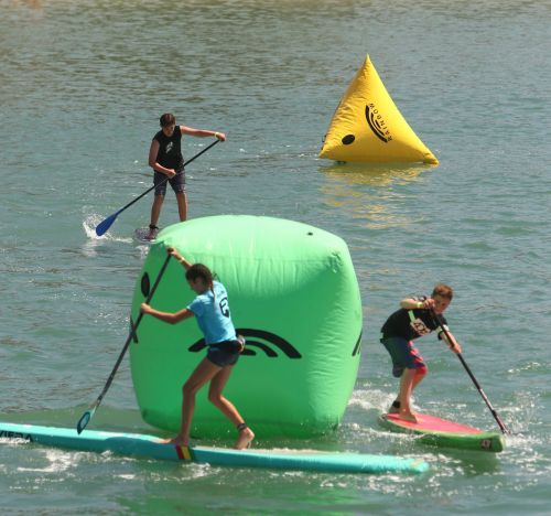 Youth racers round a buoy at the 2015 Mickey Munoz Mongoose Cup. Photo: Bill Schildge
