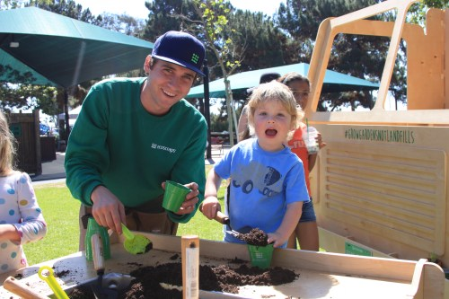 Arthur Garces, 3, plants seeds with the help of John Lacouture of Ecoscraps during the Groheny Festival, april 2 at Doheny State Beach. Ecoscraps uses food waste from stores and restaurants to produce soils and fertilizers. Photo: Andrea Swayne