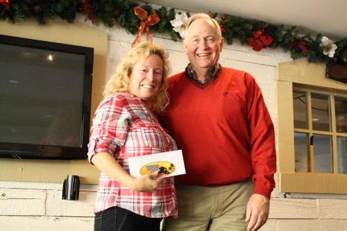 """Mike and Donna Groves received the Woody Cup for """"Making the Most of What you Got"""" for their vessel in the 42nd annual Boat Parade of Lights. Photo: Kristina Pritchett"""