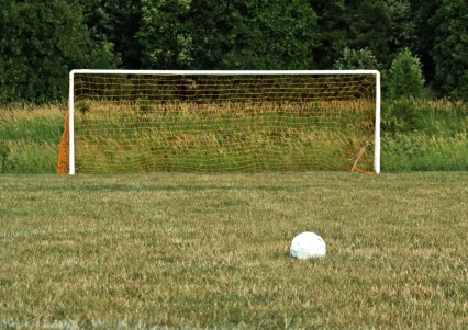 A soccer goal with the ball ready for a penalty kick - less the players...