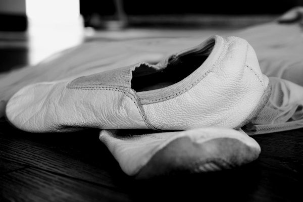 A black and white picture of some ballet shoes.