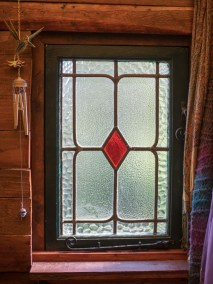 Stained glass window and cast iron casement