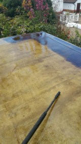 Cleaning the fibreglass roof with pressurised water