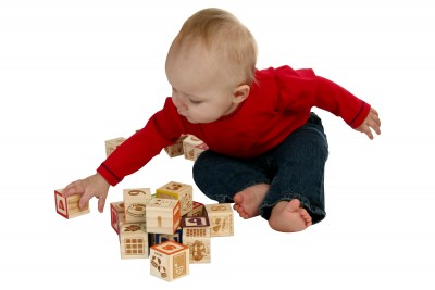Photo of child playing with blocks.