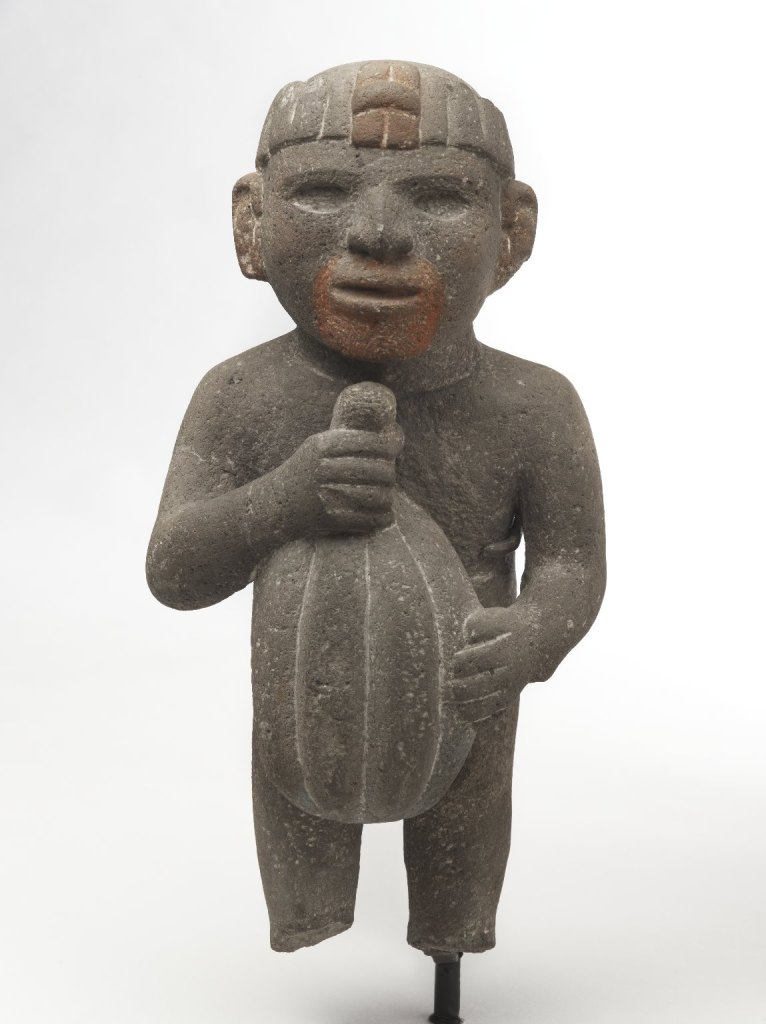 An Aztec Figure holding cacao