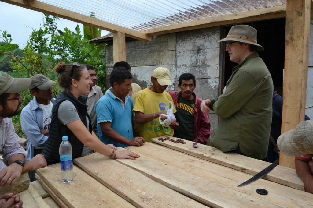 Emily Stone and Greg talking with producers at Cahabón's new drying decks.