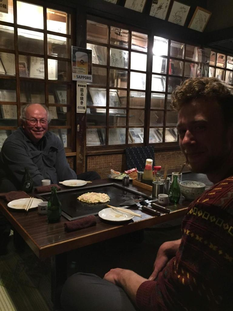 Chuck enjoying okonomiyaki in Japan