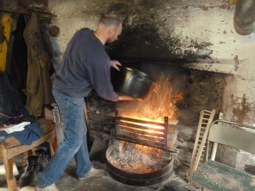 Graeme makes the sparks fly as he stokes the Workshop fire with wood shavings.