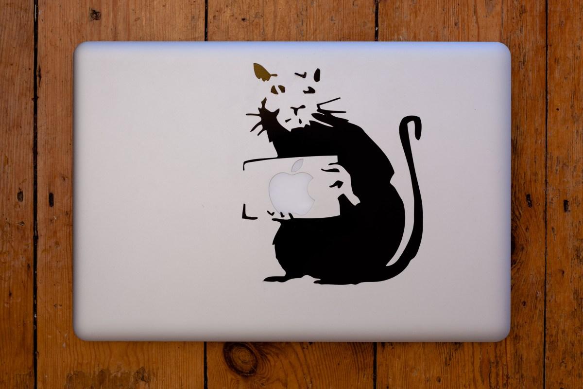 Vinyl decal of a Banksy Rat on my MacBook Pro