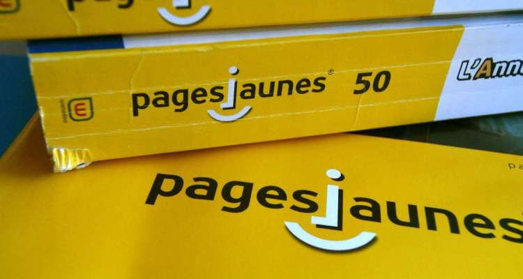 A photo taken 24 July 2006 in Caen, western France, shows PagesJaunes business directories. US private equity firm Kohlberg Kravis Roberts (KKR) has won the fight to buy France Telecom's stake in the directories business PagesJaunes, Britain's Financial Times newspaper reported 24 July 2006. By buying the 54 percent stake in PagesJaunes for 3.3 billion euros (4.2 billion dollars), KKR will trigger a 6.1 billion dollar leveraged buy-out, the biggest in France's history, the business daily said. AFP PHOTO MYCHELE DANIAU / AFP PHOTO / MYCHELE DANIAU