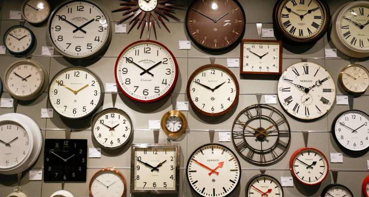Clocks are displayed inside the new John Lewis store at the Westfield shopping centre in White City, London, Britain, March 19, 2018. REUTERS/Henry Nicholls