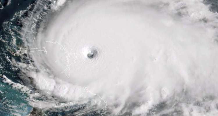 """TOPSHOT - This satellite image obtained from NOAA/RAMMB, shows Tropical Storm Dorian as it approaches the Bahamas at 13:40 UTC on September 1, 2019. Monster storm Dorian unleashed """"catastrophic conditions"""" as it hit the northwestern Bahamas Sunday, becoming the strongest hurricane ever recorded in the region, US forecasters said. """"Catastrophic hurricane conditions are occurring in the Abacos Islands and will spread across Grand Bahama Island later today and tonight,"""" the National Hurricane Center wrote in its latest bulletin at 1500 GMT.Packing maximum sustained winds of 180 miles per hour (285 kph), the NHC said Dorian was now """"the strongest hurricane in modern records for the northwestern Bahamas.""""   - RESTRICTED TO EDITORIAL USE - MANDATORY CREDIT """"AFP PHOTO / NOAA/RAMMB/HANDOUT"""" - NO MARKETING - NO ADVERTISING CAMPAIGNS - DISTRIBUTED AS A SERVICE TO CLIENTS  / AFP / NOAA/RAMMB / HO / RESTRICTED TO EDITORIAL USE - MANDATORY CREDIT """"AFP PHOTO / NOAA/RAMMB/HANDOUT"""" - NO MARKETING - NO ADVERTISING CAMPAIGNS - DISTRIBUTED AS A SERVICE TO CLIENTS"""