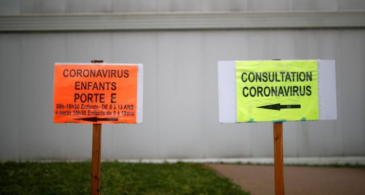 1299693-coronavirus-consultation-sign-at-an-entrance-of-the-hospital-in-vannes