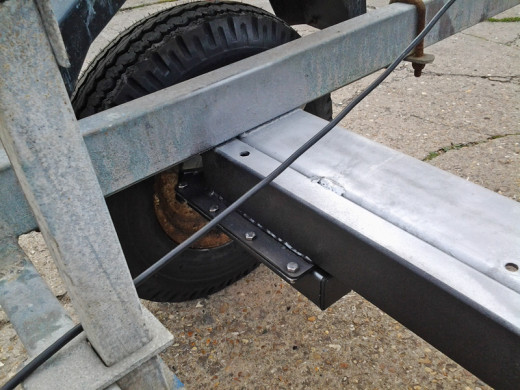 NEW AXLE AND SUSPENSION UNITS FITTED TO SNIPE BOAT TRAILER