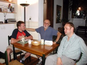 Friends Pascal, Nestor and Tuomas chat over breakfast.