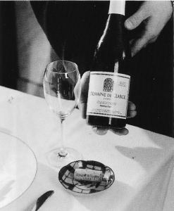 ❻ Present the cork to the host on a small plate or underliner for his or her inspection. If you have opened the bottle away from the table, present it again.