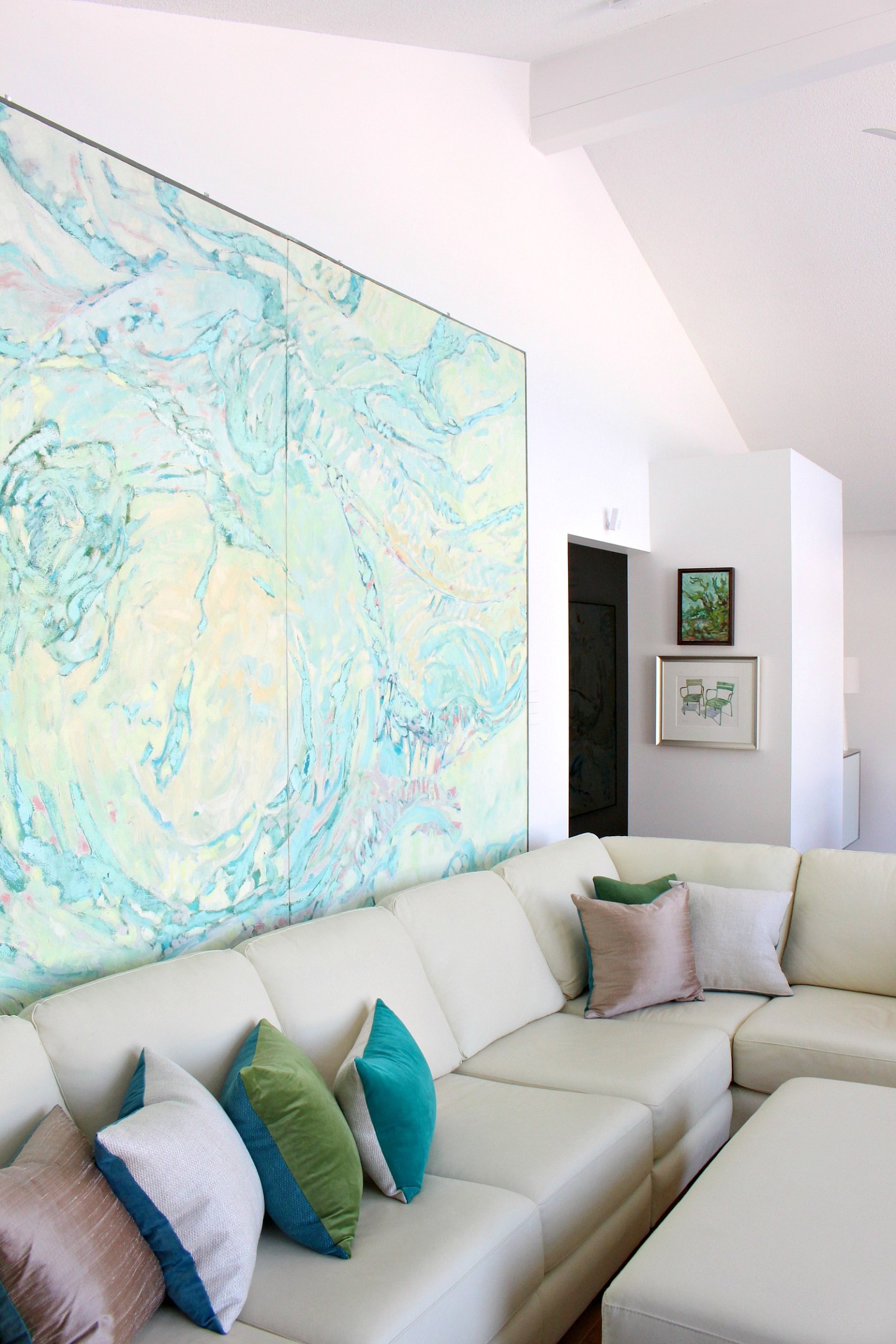 How to Hang Large Art + How to Put a Sofa in Front of Art Without Causing Damage