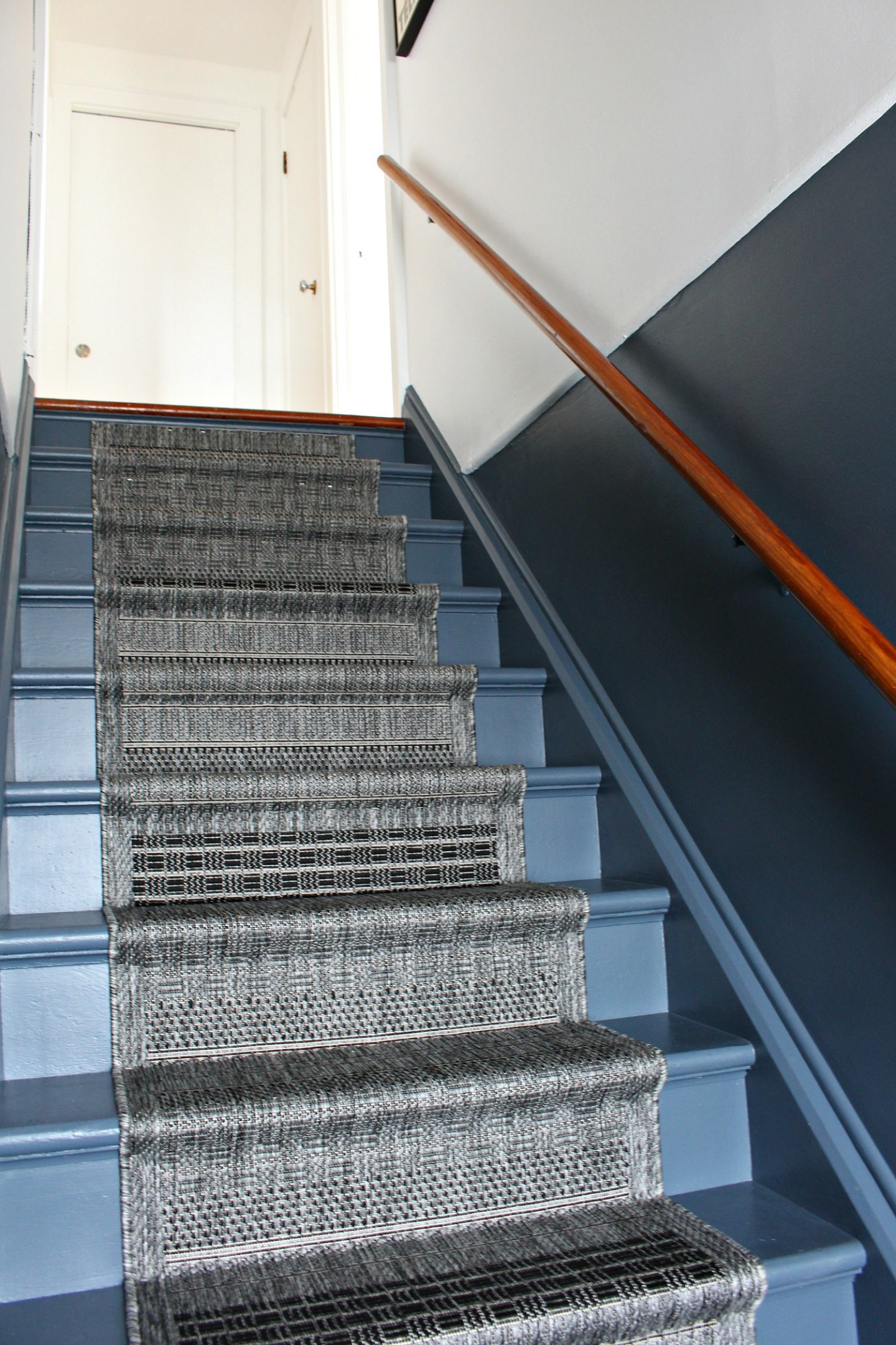 grey and white colorblocked stairs with DIY runner