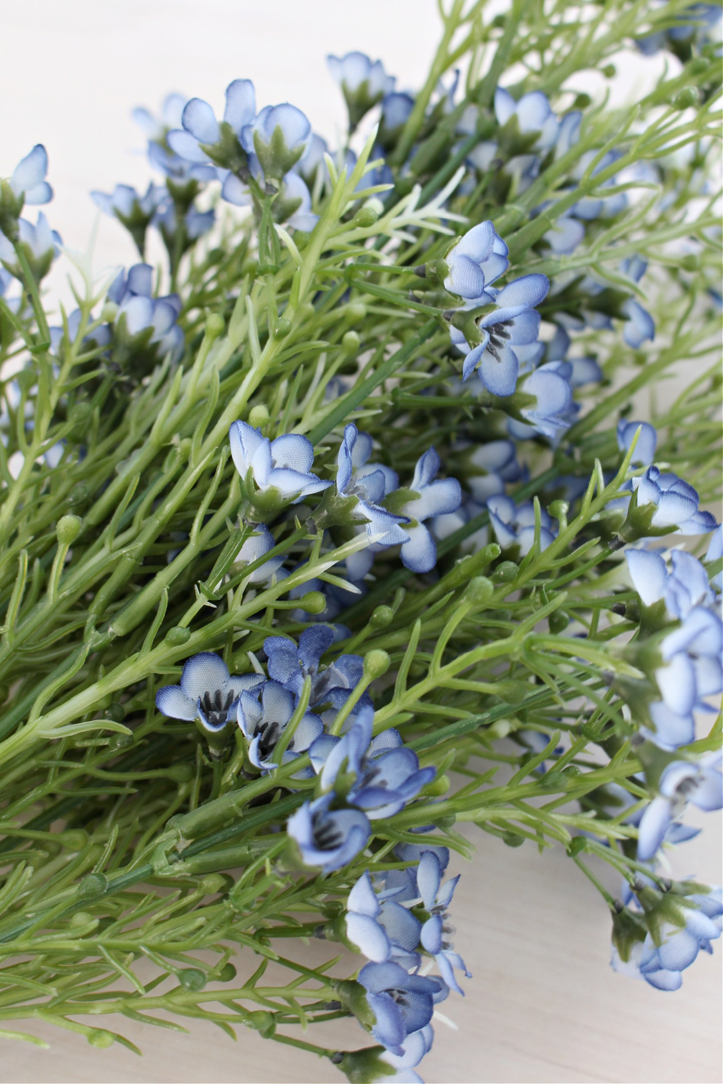 Add Faux Flowers to Branches for Spring Decor