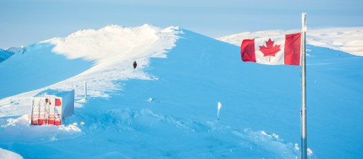 Canadian High Arctic flag and hiker