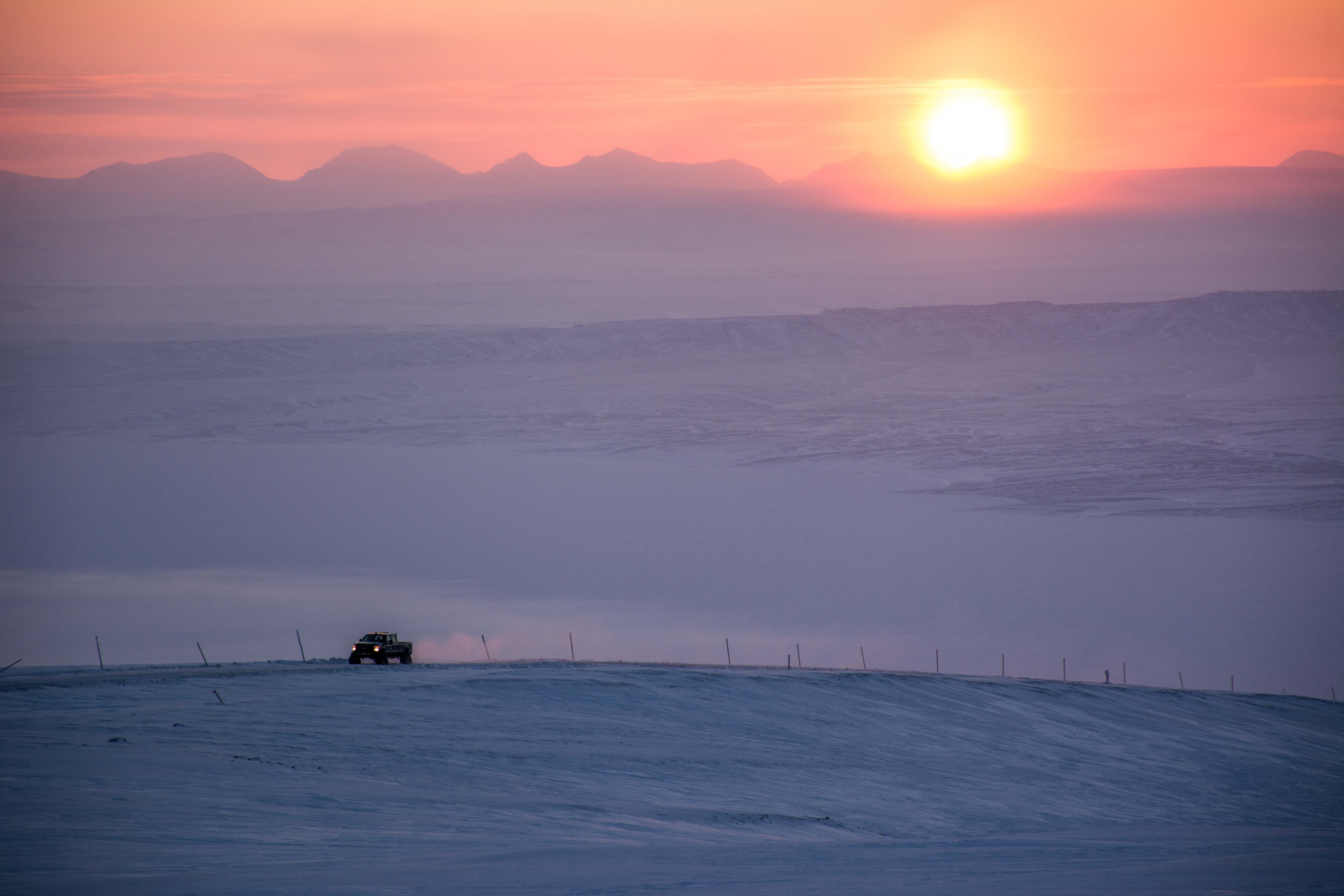 EC driving to PEARL with a high Arctic sunrise and mountains