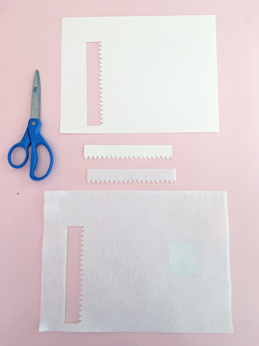 How To Make a Felt Dinosaur Bag Tutorial: Teeth cut out of white construction paper and white felt