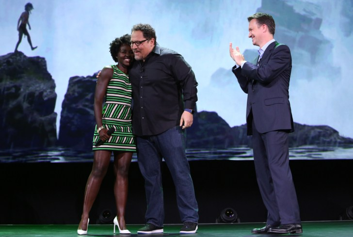 """ANAHEIM, CA - AUGUST 15: (L-R) Actress Lupita Nyong'o and director Jon Favreau of THE JUNGLE BOOK and President of Walt Disney Studios Motion Picture Production Sean Bailey took part today in """"Worlds, Galaxies, and Universes: Live Action at The Walt Disney Studios"""" presentation at Disney's D23 EXPO 2015 in Anaheim, Calif. (Photo by Jesse Grant/Getty Images for Disney) *** Local Caption *** Lupita Nyong'o; Jon Favreau; Sean Bailey"""