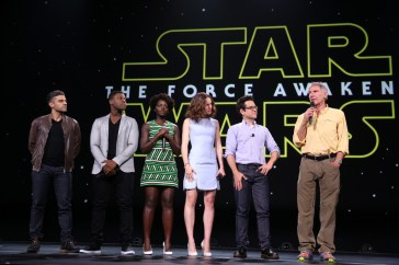 """ANAHEIM, CA - AUGUST 15: (L-R) Actors Oscar Isaac, John Boyega, Lupita Nyong'o, Daisy Ridley, director J.J. Abrams and actor Harrison Ford of STAR WARS: THE FORCE AWAKENS took part today in """"Worlds, Galaxies, and Universes: Live Action at The Walt Disney Studios"""" presentation at Disney's D23 EXPO 2015 in Anaheim, Calif. (Photo by Jesse Grant/Getty Images for Disney) *** Local Caption *** Oscar Isaac; John Boyega; Lupita Nyong'o; Daisy Ridley; J.J. Abrams; Harrison Ford"""