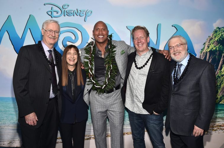 """HOLLYWOOD, CA - NOVEMBER 14: (L-R) Co-director John Musker, Producer Osnat Shurer, actor Dwayne Johnson, Screenwriter Jared Bush and Co-Director Ron Clements attend The World Premiere of Disney's """"MOANA"""" at the El Capitan Theatre on Monday, November 14, 2016 in Hollywood, CA. (Photo by Alberto E. Rodriguez/Getty Images for Disney) *** Local Caption *** John Musker; Osnat Shurer; Dwayne Johnson; Jared Bush; Ron Clements"""