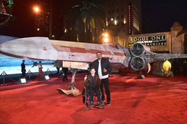 "HOLLYWOOD, CA - DECEMBER 10: Actor Micah Fowler (L) and guest attend The World Premiere of Lucasfilm's highly anticipated, first-ever, standalone Star Wars adventure, ""Rogue One: A Star Wars Story"" at the Pantages Theatre on December 10, 2016 in Hollywood, California. (Photo by Marc Flores/Getty Images for Disney) *** Local Caption *** Micah Fowler"