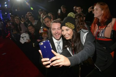 "HOLLYWOOD, CA - DECEMBER 10: TV personality Chris Hardwick (L) poses with a fan at The World Premiere of Lucasfilm's highly anticipated, first-ever, standalone Star Wars adventure, ""Rogue One: A Star Wars Story"" at the Pantages Theatre on December 10, 2016 in Hollywood, California. (Photo by Jesse Grant/Getty Images for Disney) *** Local Caption *** Chris Hardwick"