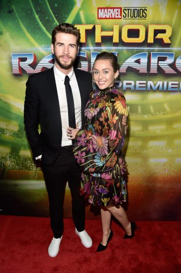 """HOLLYWOOD, CA - OCTOBER 10: Actor Liam Hemsworth (L) and Miley Cyrus at The World Premiere of Marvel Studios' """"Thor: Ragnarok"""" at the El Capitan Theatre on October 10, 2017 in Hollywood, California. (Photo by Alberto E. Rodriguez/Getty Images for Disney) *** Local Caption *** Liam Hemsworth; Miley Cyrus"""
