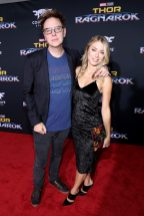 """HOLLYWOOD, CA - OCTOBER 10: Screenwriter James Gunn (L) and Jennifer Holland at The World Premiere of Marvel Studios' """"Thor: Ragnarok"""" at the El Capitan Theatre on October 10, 2017 in Hollywood, California. (Photo by Rich Polk/Getty Images for Disney) *** Local Caption *** James Gunn; Jennifer Holland"""