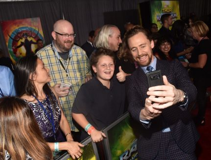 """HOLLYWOOD, CA - OCTOBER 10: Actor Tom Hiddleston (R) poses with fans at The World Premiere of Marvel Studios' """"Thor: Ragnarok"""" at the El Capitan Theatre on October 10, 2017 in Hollywood, California. (Photo by Alberto E. Rodriguez/Getty Images for Disney) *** Local Caption *** Tom Hiddleston"""