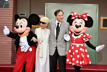 BURBANK, CA - JULY 30: (L-R) Mickey Mouse, Elizabeth Sherman, Songwriter Richard M. Sherman and Minnie Mouse attend the dedication and re-naming of the historic Orchestra Stage, now the Sherman Brothers Stage A, on the Disney Burbank lot prior to the world premiere of Disney's 'Christopher Robin' at the studio's Main Theater, on July 30, 2018. (Photo by Alberto E. Rodriguez/Getty Images for Disney) *** Local Caption *** Mickey Mouse; Elizabeth Sherman; Richard M. Sherman; Minnie Mouse