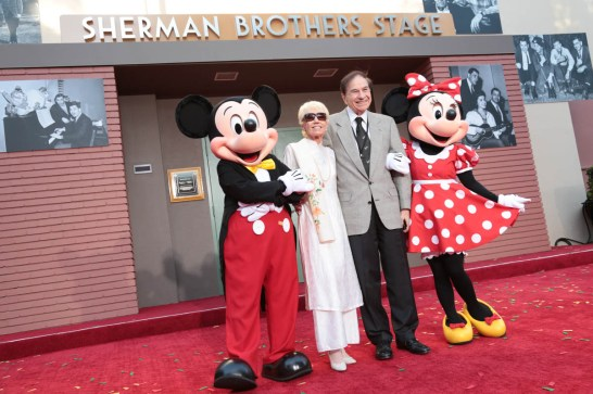 """Mickey Mouse, Elizabeth Sherman, Richard M. Sherman and Minnie Mouse share a moment at the dedication and re-naming of the historic Orchestra Stage, now the Sherman Brothers Stage A, on the Disney Burbank lot prior to the world premiere of Disney's """"Christopher Robin"""" at the studio's Main Theater, on July 30, 2018 in Burbank, CA (Photo: Alex J. Berliner/ABImages)"""
