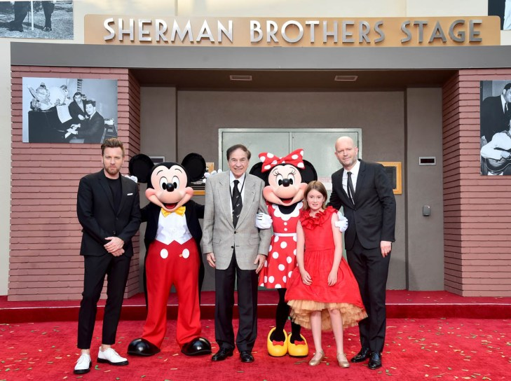 BURBANK, CA - JULY 30: (L-R) Actor Ewan McGregor, Mickey Mouse, Songwriter Richard M. Sherman, Minnie Mouse, Actor Bronte Carmichael and Director Marc Forster attend the dedication and re-naming of the historic Orchestra Stage, now the Sherman Brothers Stage A, on the Disney Burbank lot prior to the world premiere of Disney's 'Christopher Robin' at the studio's Main Theater, on July 30, 2018. (Photo by Alberto E. Rodriguez/Getty Images for Disney) *** Local Caption *** Ewan McGregor; Mickey Mouse; Marc Forster; Richard M. Sherman; Bronte Carmichael; Minnie Mouse
