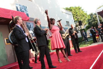 """SideStreet Strutters perform during the dedication and re-naming of the historic Orchestra Stage, now the Sherman Brothers Stage A, on the Disney Burbank lot prior to the world premiere of Disney's """"Christopher Robin"""" at the studio's Main Theater, on July 30, 2018 in Burbank, CA (Photo: Alex J. Berliner/ABImages)"""