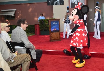 BURBANK, CA - JULY 30: Elizabeth Sherman, Songwriter Richard M. Sherman and Minnie Mouse attend the dedication and re-naming of the historic Orchestra Stage, now the Sherman Brothers Stage A, on the Disney Burbank lot prior to the world premiere of Disney's 'Christopher Robin' at the studio's Main Theater, on July 30, 2018. (Photo by Alberto E. Rodriguez/Getty Images for Disney) *** Local Caption *** Elizabeth Sherman; Richard M. Sherman; Minnie Mouse