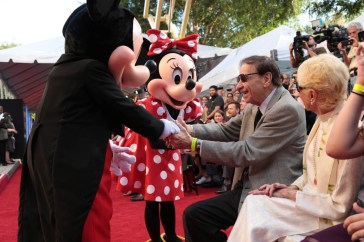 """Mickey Mouse, Minnie Mouse and Richard M. Sherman share a moment at the dedication and re-naming of the historic Orchestra Stage, now the Sherman Brothers Stage A, on the Disney Burbank lot prior to the world premiere of Disney's """"Christopher Robin"""" at the studio's Main Theater, on July 30, 2018 in Burbank, CA (Photo: Alex J. Berliner/ABImages)"""