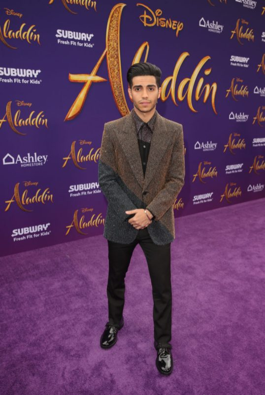"LOS ANGELES, CA - MAY 21: Mena Massoud attends the World Premiere of Disney's ""Aladdin"" at the El Capitan Theater in Hollywood CA on May 21, 2019, in the culmination of the film's Magic Carpet World Tour with stops in Paris, London, Berlin, Tokyo, Mexico City and Amman, Jordan. (Photo by Jesse Grant/Getty Images for Disney) *** Local Caption *** Mena Massoud"