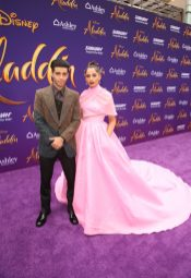 "LOS ANGELES, CA - MAY 21: Mena Massoud (L) and Naomi Scott attend the World Premiere of Disney's ""Aladdin"" at the El Capitan Theater in Hollywood CA on May 21, 2019, in the culmination of the film's Magic Carpet World Tour with stops in Paris, London, Berlin, Tokyo, Mexico City and Amman, Jordan. (Photo by Jesse Grant/Getty Images for Disney) *** Local Caption *** Mena Massoud; Naomi Scott"