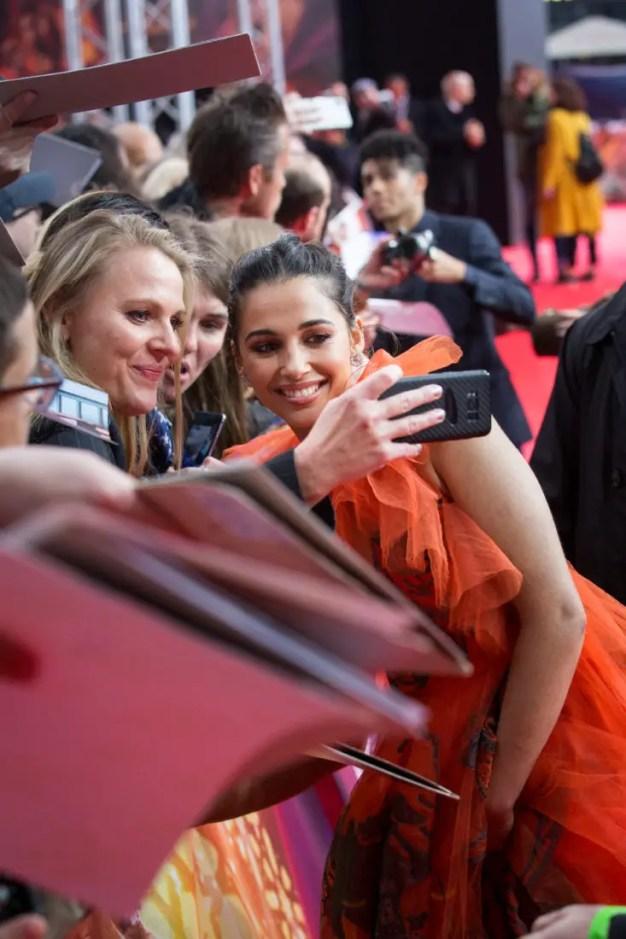 "Mena Massoud and Naomi Scott attend the ""Aladdin"" gala screening on May 11, 2019 in Berlin, Germany. .© Disney/Folioscope/Hanna Boussouar"